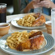 Swiss Chalet Coupons: 2 Quarter Chicken Dinners for $16 (Dine-in) or 2 Quarter Chicken Dinners + 2 Drinks for $20 (Delivery)